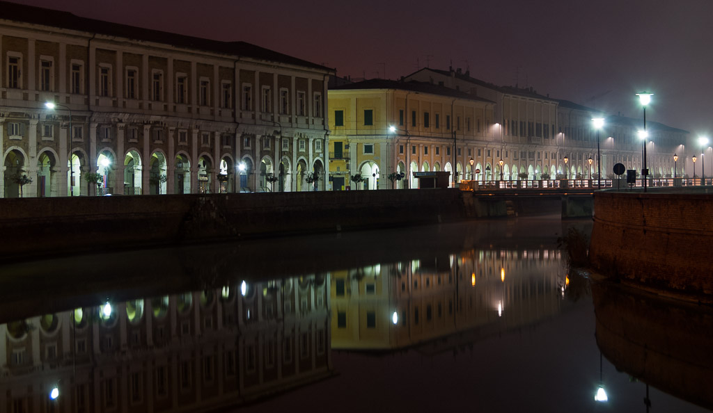 Portici Ercolani reflected in Misa river at night