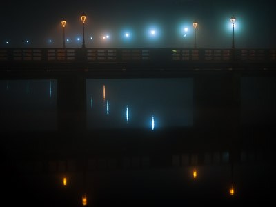 Corso II Giugno bridge reflected in Misa river at night