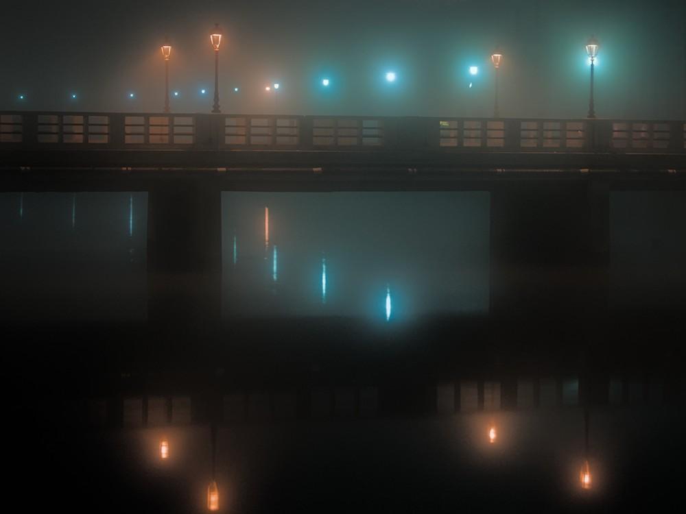 Corso II Giugno bridge reflected in Misa river at night