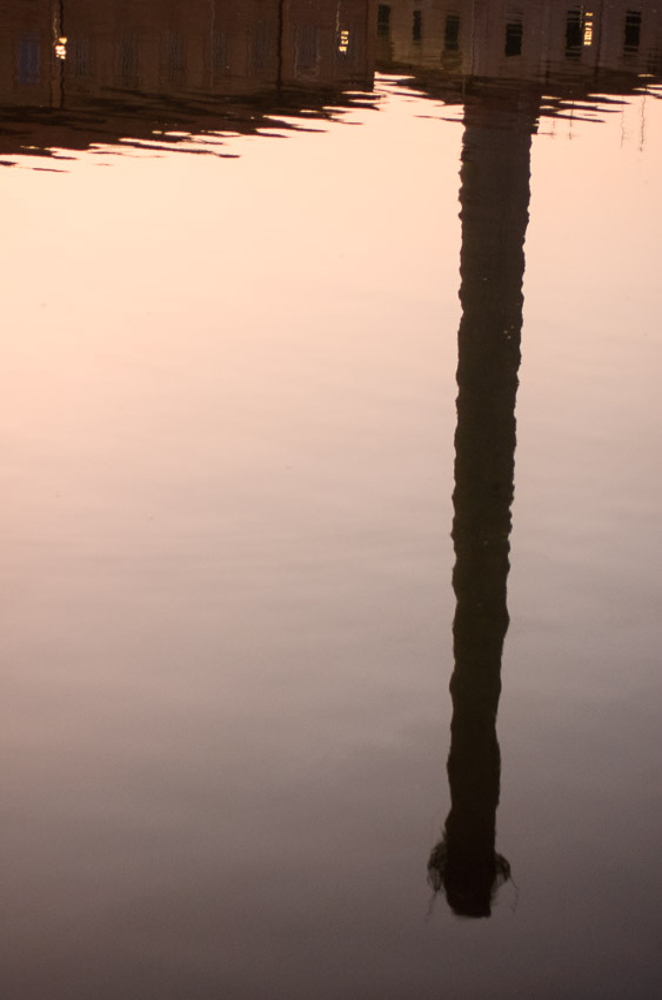 Chimney reflected at the harbor