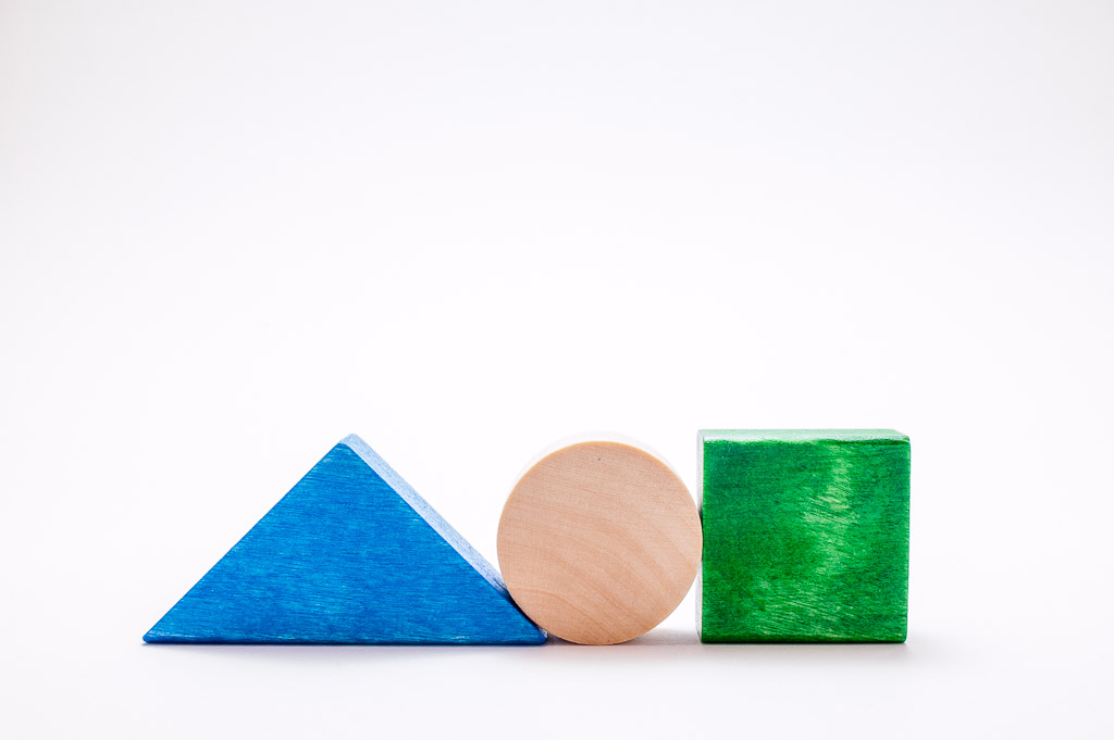 Triangle, circle and square with wooden blocks