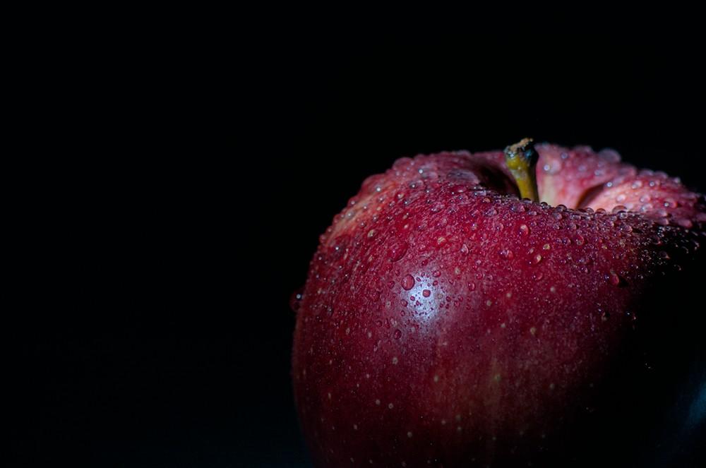 Royal Gala apple on black