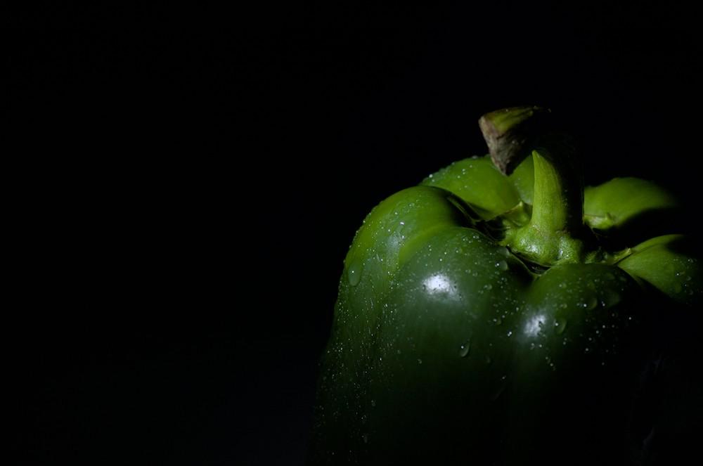 Green bell pepper on black