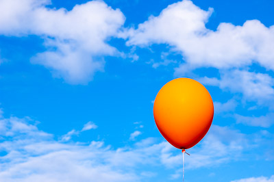 Orange baloon against the sky