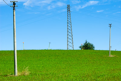 Green field with electic poles