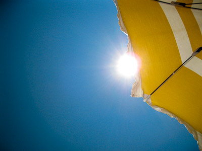 Sun through beach umbrella
