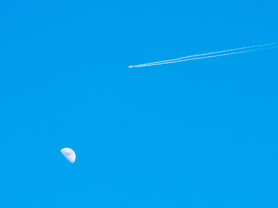 Airplane and the moon