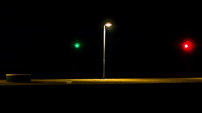 Street light and lighthouses at night