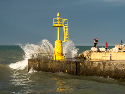 Windy sea and yellow lighthouse